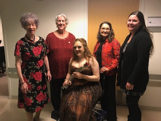 Madison Alumnae SAI sisters Carol Fosshage, Martha Dodds Stoner, Sue Poulette, and Laura McGuire present violinist Rachel Barton Pine with a red rose after her fall 2019 concert in Madison, Wisconsin.